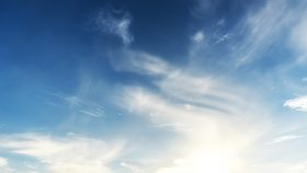An image of a blue sky with white clouds.