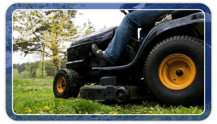 Image of someone mowing their lawn during the Fall