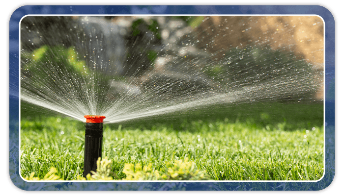 Image of a sprinkler watering a lawn