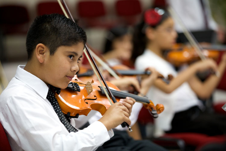 Indy STEAM Academy male student playing violin