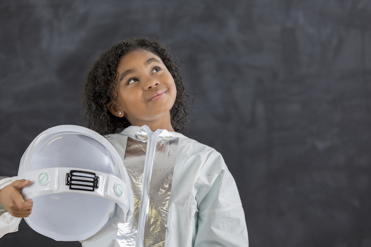young female astronaut looks to the future at Indy STEAM Academy
