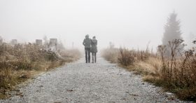 couple walking in fog