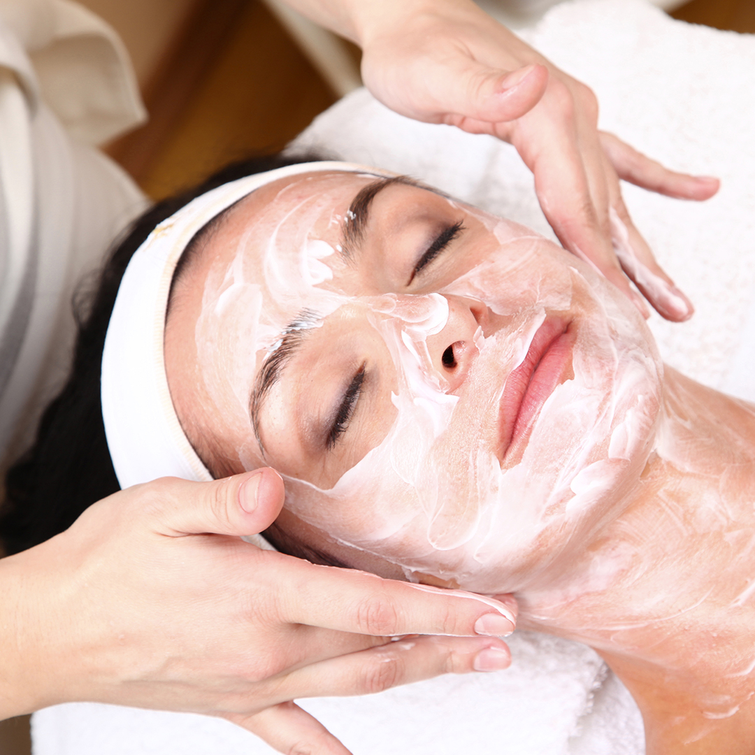 an image of a woman receiving a facial at a day spa