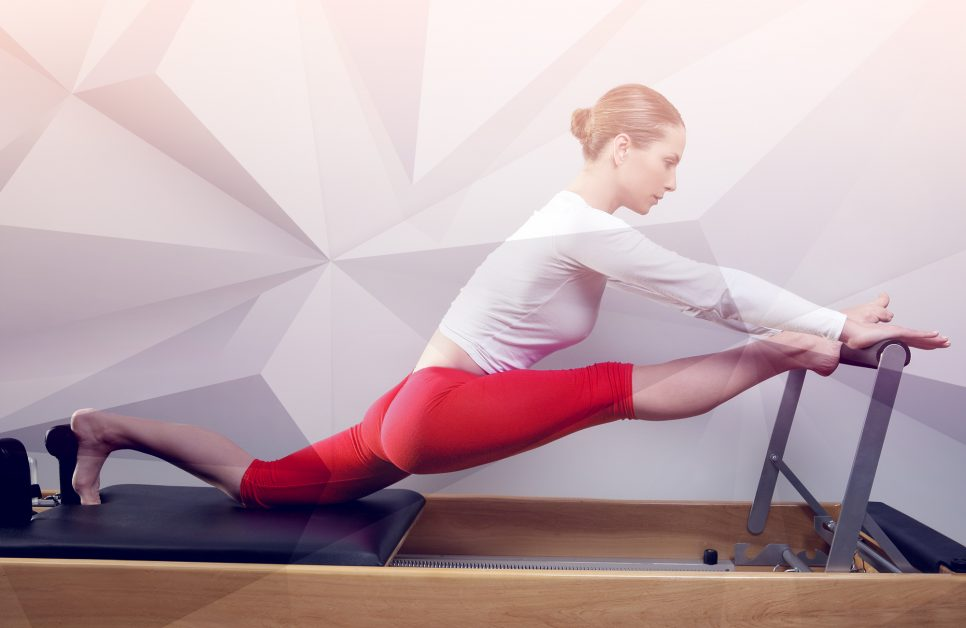 Woman working out on Lagree Megaformer