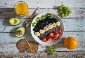 An image of a smoothie bowl surrounded by other healthy foods.