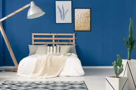 Bedroom With Bright Blue Walls