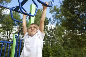 photo boy on monkey bars