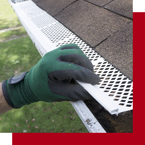 Woman inspecting gutter guards before she puts them on her home