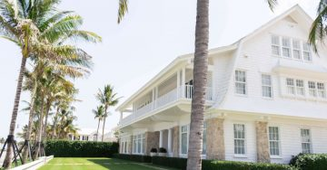 Image of a white house surrounded by palm trees in Florida.
