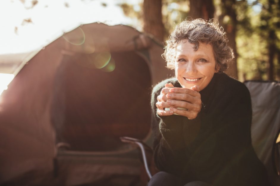 Woman Enjoying Coffee in Front of Tent