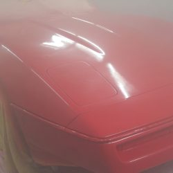 A car in the process getting new body paint - J & C Professional Services