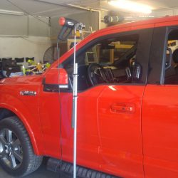 A Ford being worked on with auto tools - J & C Professional Services