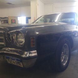 Closeup of a classic Dodge car's front fender - J & C Professional Services