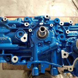 A bright blue hydraulic double gear pump - J & C Professional Services