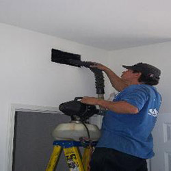 Specialist Cleaning Overhead HVAC Vent