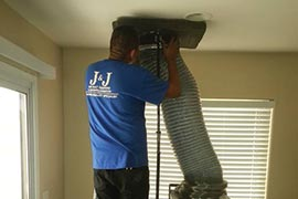 HVAC Tech Performing a Home Cleaning