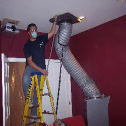 Specialist on Ladder Cleaning Vent