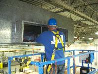 Cleaning Specialist Reaching Into Commercial Ducts