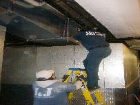Duct Cleaning Specialist on a Ladder