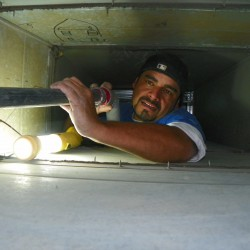 Specialist Checking Duct Interior
