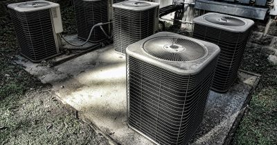 Four Old AC Units on a Pad