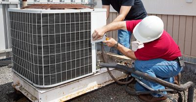 HVAC Technicians Checking AC Unit