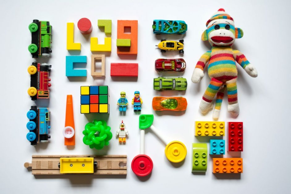 An array of multicolored toys and learning aids commonly found in daycare centers. Photo by Vanessa Bucceri on Unsplash.
