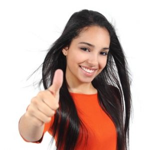 Beautiful woman with perfect white smile with thumb up