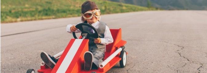 kid racing in a go kart