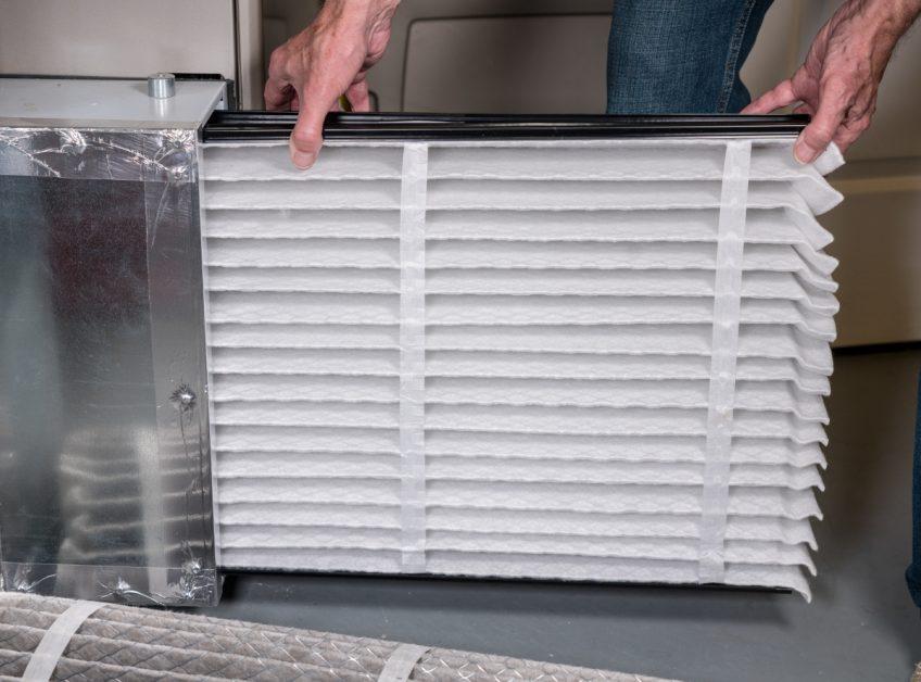 Man Replacing Air Filter for Furnace
