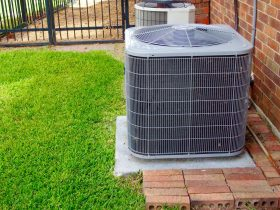 AC Unit Next to Lawn and Home