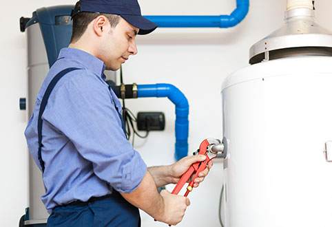 Man Working on Commercial Furnace