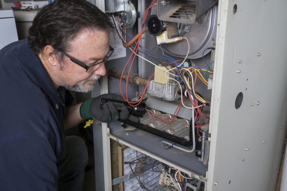 HVAC Technician Checking Furnace