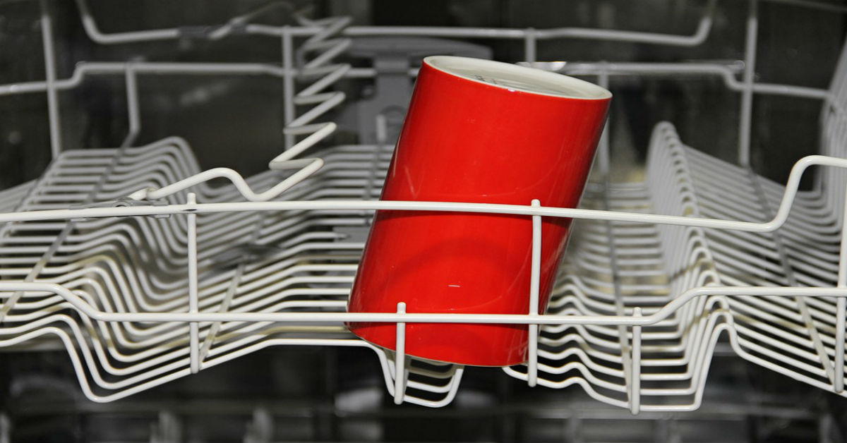 Dishwasher rack with cup in it