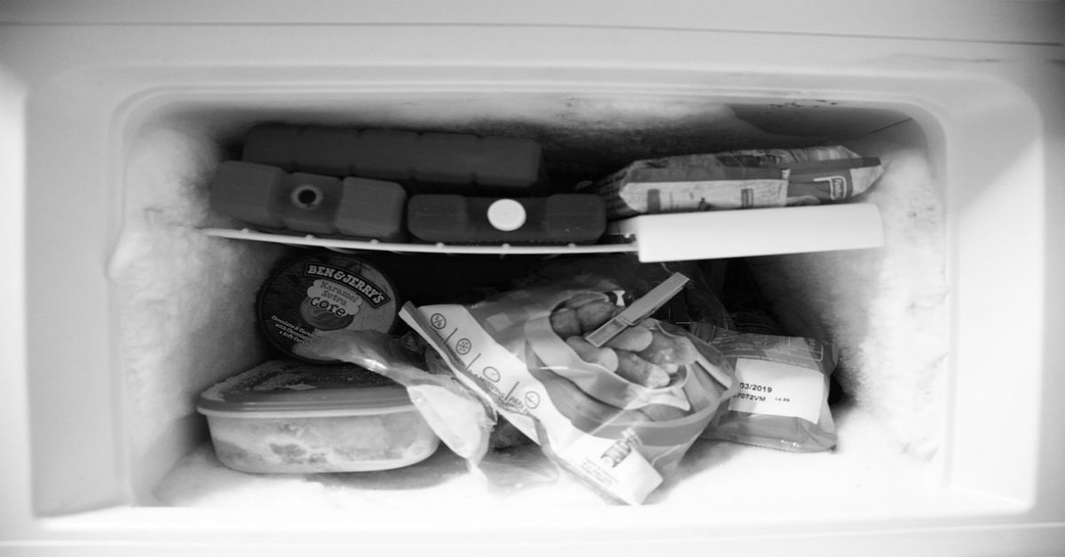 Freezer with ice buildup filled with food