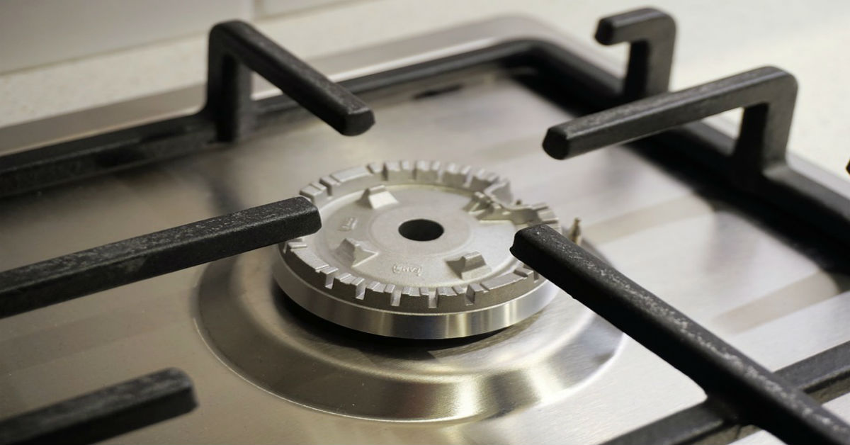 Closeup of gas burner on an oven