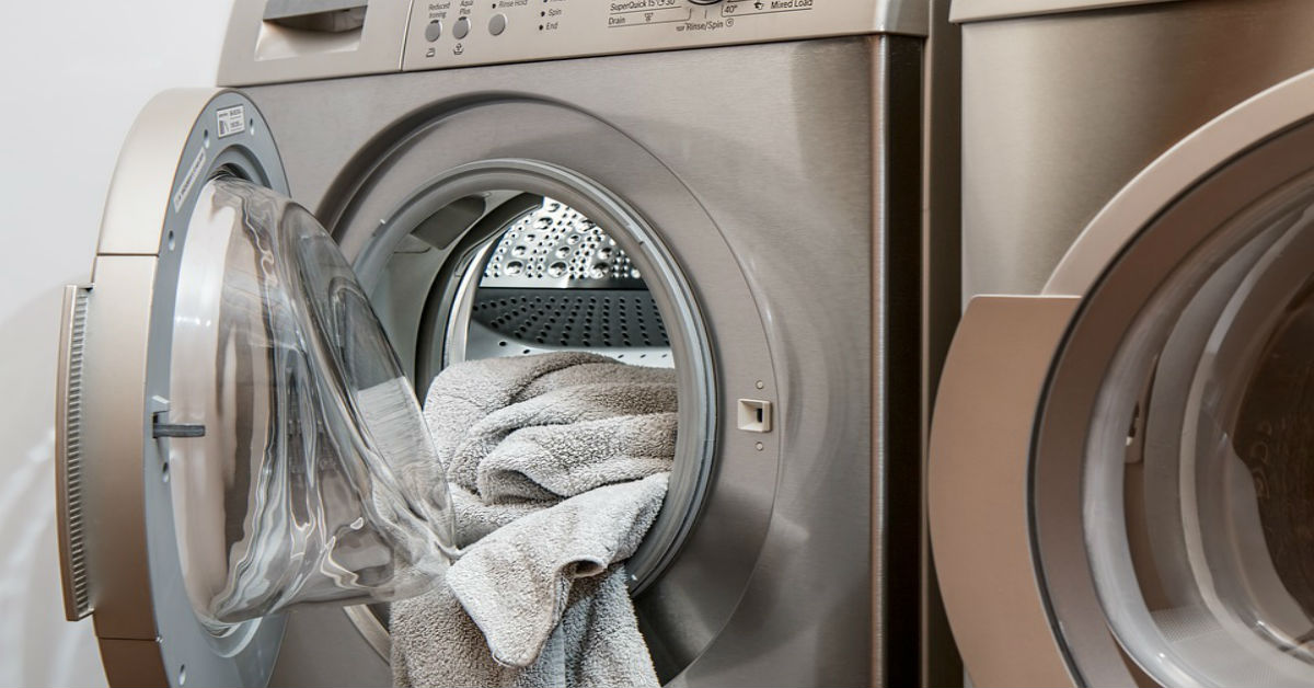 Open clothes dryer with towels in it
