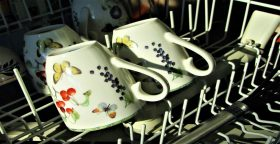 closeup of teacups in a dishwasher rack