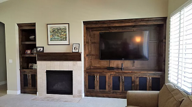 Living room with oak entertainment center and tiled fireplace