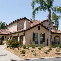 Home with red clay roof that just received custom home remodeling
