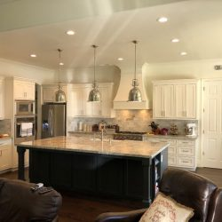 Fresno kitchen renovation with black kitchen island and white custom cabinetry