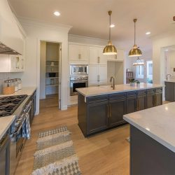 Dark grey cabinets and light hardwood flooring in a Fresno kitchen renovation