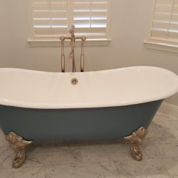 Blue clawfoot bathtub with white interior - J&J Quality Construction