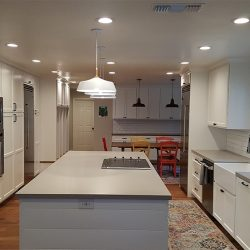 White cabinetry and kitchen island in a Clovis kitchen remodel