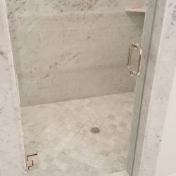 White marbled shower with glass door - J&J Quality Construction - Image 3