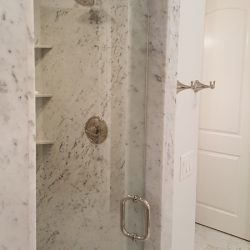 White marbled shower with glass door - J&J Quality Construction