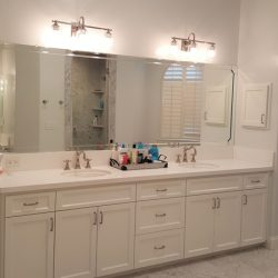 Bathroom with white cabinets and white marble tiled floor - J&J Quality Construction