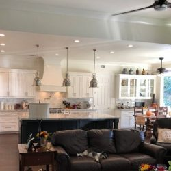White kitchen design with black kitchen island in Clovis