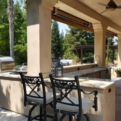Outdoor remodeling with sandy colored granite countertops