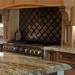 Custom Clovis kitchen remodel with sandy kitchen cabinets and granite countertops